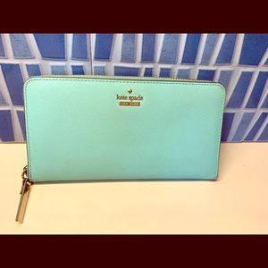 Kate spade turquoise leather wallet.